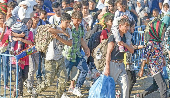Germany warns at 'limit of capacity' as migrant numbers surge