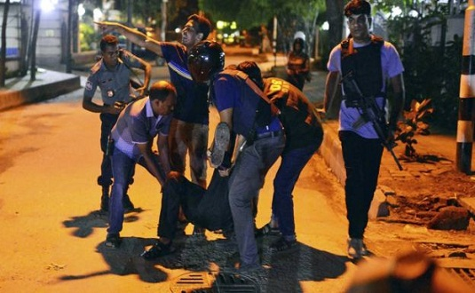 IS gunmen seize hostages at Dhaka cafe, 2 officers down